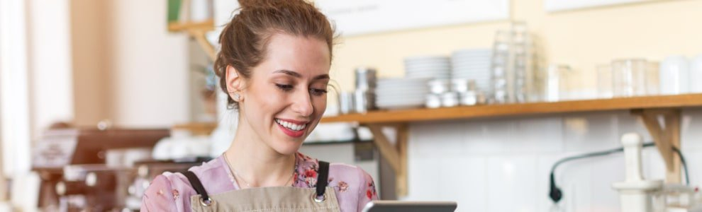 Waitress in apron with iPad