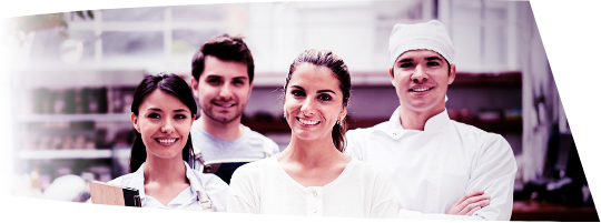 Restaurant manager with waiters and chef